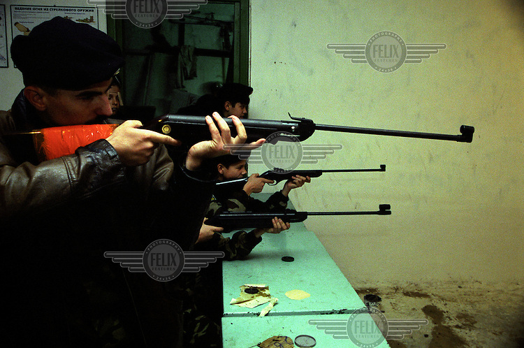 Cadet students of the Stavropol Cossack Academy practice shooting on an indoor range.
