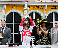 BALTIMORE, MD - MAY 20: Cloud Computing jockey Javier Castellano holds up the trophy after winning the 142nd Preakness Stakes on Preakness Stakes Day at Pimlico Race Course on May 20, 2017 in Baltimore, Maryland.(Photo by Sue Kawczynski/Eclipse Sportswire/Getty Images)