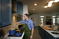 NWA Democrat-Gazette/BEN GOFF @NWABENGOFF<br /> Matt McClure, executive chef of The Hive restaurant at 21c Museum Hotel, cooks Sunday, April 2, 2017, at his home in Bentonville.
