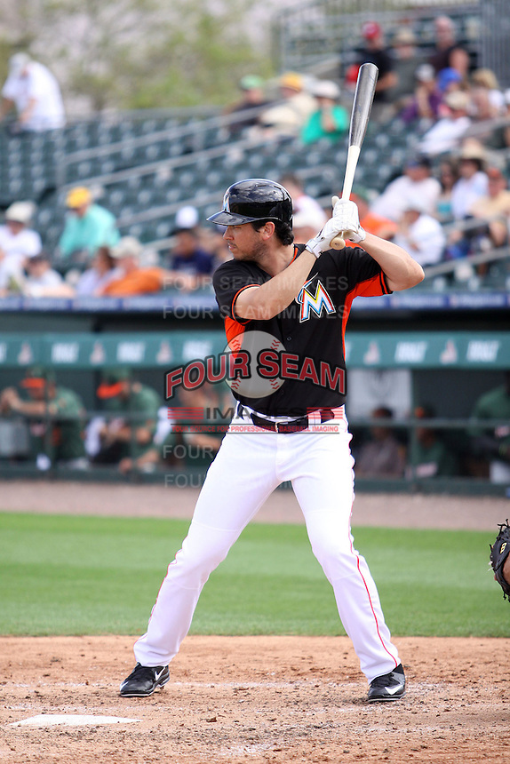 Tyler Colvin (26) at bat for the Miami Marlins during a spring training game against the University of Miami Hurricanes at the Roger Dean Complex in Jupiter, Florida on March 3, 2015. Miami defeated UM 7-1. (Stacy Jo Grant/Four Seam Images)
