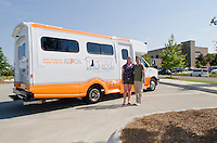 One of the founders of homeward bound Amy White and Director of Operations: Terri Snead stand in front of new homeward bound project van. http://www.homewardboundofms.org/about-us.html
