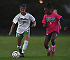 Sydney Moore #15 of Farmingdale, left, gets pressured by Kaia Harrison #21 of Baldwin during a Nassau County Conference AA-1 varsity girls soccer game at Baldwin High School on Wednesday, Oct. 17, 2018. Moore scored a goal in the early in the second half to extend Farmingdale's lead to 3-1. The Dalers went on to win by that same score.