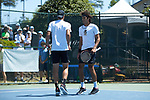 Borna Gojo (left) of the Wake Forest Demon Deacons slaps hands with teammate Skander Mansouri during their match at #1 doubles against the North Carolina Tar Heels at the 2018 ACC Men's Tennis Championship at the Cary Tennis Center on April 29, 2018 in Cary, North Carolina.  The Demon Deacons defeated the Tar Heels 4-0.  (Brian Westerholt/Sports On Film)