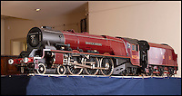 BNPS.co.uk (01202) 558833<br /> Picture: Laura Jones<br /> <br /> A fine exhibition standard 7 1/4 inch gauge model of London, Midland and Scottish Railway Coronation Class 7P 4-6-2 4-6-2 tender locomotive 'Duchess of Abercorn' valued at &pound;40,000-50,000<br /> <br /> A train enthusiast's stunning collection of model steam engines he used to happily drive around his garden is tipped to sell for 200,000 pounds. With the help of his family the late Don Witheridge laid three-quarters of a mile of track on his five acres of land he bought from British Rail and commissioned prominent locomotive builders to make model steam engines. The locos are exact working replicas of real engines from the golden age of steam