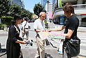 General view, JUNE 15, 2014 - Football / Soccer :   Newspaper staff hands out an extra edition about the FIFA World Cup Brazil 2014 Group C match between Japan and Cote d'Ivoire in Tokyo, Japan. (Photo by AFLO SPORT) [1156]