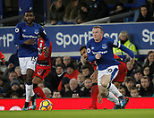 2nd December 2017, Goodison Park, Liverpool, England; EPL Premier League football, Everton versus Huddersfield Town; Wayne Rooney of Everton runs through midfield as Cuco Martina looks on