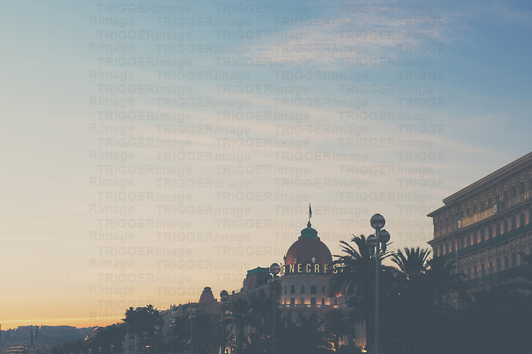 The sun sets over the Hotel Negresco on the French Riviera.