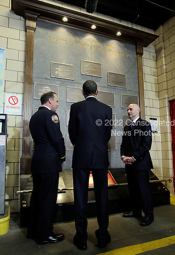 United States President Barack Obama views a memorial honoring deceased members of the FDNY at Engine 54 Fire House days after Osama Bin Laden was killed by U.S. Navy Seals almost 10 years after the terrorist attacks on the World Trade Center in New York on May 5, 2011.  .Credit: John Angelillo / Pool via CNP