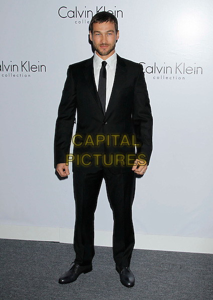 ANDY WHITFIELD.Attending Calvin Klein Collection and LOS ANGELES NOMADIC DIVISION present a celebration of L.A. Arts Month held at the Calvin Klein Store, Los Angeles, CA, USA, 28th January 2010..full length black suit tie white shirt .CAP/ADM/MJ.©Michael Jade/Admedia/Capital Pictures