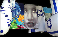2. &quot;Jaffa is more than Oranges&quot;:  beach towels and inflatable toys in a shopfront display, Tel Aviv.<br />