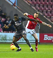 Lincoln City's John Akinde shields the ball from  Crewe Alexandra's Paul Green<br /> <br /> Photographer Andrew Vaughan/CameraSport<br /> <br /> The EFL Sky Bet League Two - Crewe Alexandra v Lincoln City - Wednesday 26th December 2018 - Alexandra Stadium - Crewe<br /> <br /> World Copyright &copy; 2018 CameraSport. All rights reserved. 43 Linden Ave. Countesthorpe. Leicester. England. LE8 5PG - Tel: +44 (0) 116 277 4147 - admin@camerasport.com - www.camerasport.com
