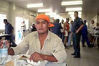 - South American worker in yard refectory of new Milan fair at Rho-Pero....- operaio sudamericano nella mensa del cantiere della nuova fiera di Milano a Rho-Pero