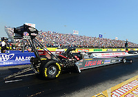 Sept. 22, 2012; Ennis, TX, USA: NHRA top fuel dragster driver Chris Karamesines (near lane) races alongside Scott Palmer during qualifying for the Fall Nationals at the Texas Motorplex. Mandatory Credit: Mark J. Rebilas-US PRESSWIRE