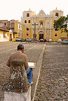 Artist sketching La Merced Church in Antigua, Guatemala. Antigua is a UNESCO World heritage site...