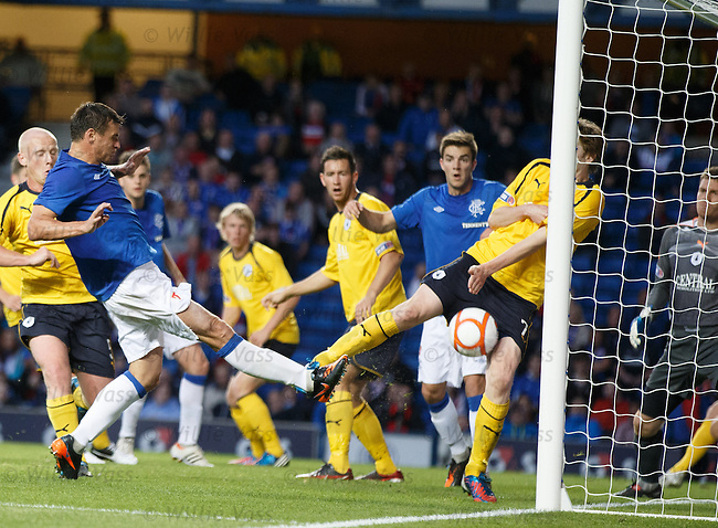 Lee McCulloch's goalbound effort is denied on the line by a dull smack in the stones from a Falkirk defender