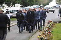 Pictured: Swansea City first team players, led by their captain Ashley Williams (C) and followed by team mates Nathan Dyer, Wayne Routledge, Ben Davies, Leon Britton, Chico Flores, Angel Rangel, Alejandro Pozuelo and others, arriving at Morriston Crematorium.<br />