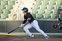 Kyle Ruchim (8) of the Kannapolis Intimidators follows through on his swing against the Greenville Drive at Intimidators Stadium on June 8, 2016 in Kannapolis, North Carolina.  The Intimidators defeated the Drive 3-2.  (Brian Westerholt/Four Seam Images)