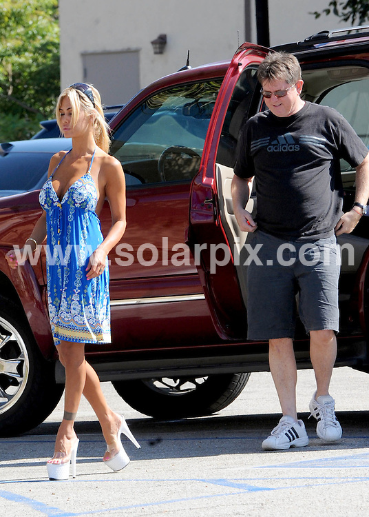 **ALL ROUND EXCLUSIVE PICTURES FROM SOLARPIX.COM**                                             **SYNDICATION RIGHTS FOR UK AND SPAIN ONLY**                                                                                  Caption: Shauna Sand - American actress and Playboy Playmate - does a back parking lot deal to get some lucite healed shoes in Hollywood. Shauna leaves with three pairs. Los Angeles, California, USA. 19 September 2010                                                                           This pic: Shauna Sand                                                                                       JOB REF: 12130 STL       DATE: 19_09_2010                                                           **MUST CREDIT SOLARPIX.COM OR DOUBLE FEE WILL BE CHARGED**                                                                      **MUST AGREE FEE BEFORE ONLINE USAGE**                               **CALL US ON: +34 952 811 768 or LOW RATE FROM UK 0844 617 7637**