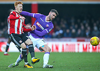 Brentford's Ryan Woods gets away from Bolton Wanderers' Gary Madine<br /> <br /> Photographer Alex Dodd/CameraSport<br /> <br /> The EFL Sky Bet Championship - Brentford v Bolton Wanderers - Saturday 13th January 2018 - Griffin Park - Brentford<br /> <br /> World Copyright &copy; 2018 CameraSport. All rights reserved. 43 Linden Ave. Countesthorpe. Leicester. England. LE8 5PG - Tel: +44 (0) 116 277 4147 - admin@camerasport.com - www.camerasport.com