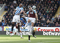 Burnley's Sam Vokes fails to direct an early headed effort on target under pressure from Huddersfield Town's Mathias Zanka Jorgensen<br /> <br /> Photographer Rich Linley/CameraSport<br /> <br /> The Premier League - Burnley v Huddersfield Town - Saturday 6th October 2018 - Turf Moor - Burnley<br /> <br /> World Copyright &copy; 2018 CameraSport. All rights reserved. 43 Linden Ave. Countesthorpe. Leicester. England. LE8 5PG - Tel: +44 (0) 116 277 4147 - admin@camerasport.com - www.camerasport.com