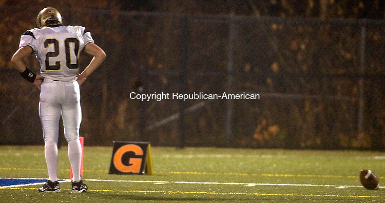 WATERBURY, CT - 14 NOVEMBER 2008 -111408JT12-<br /> Woodland's Tyler Slapikas pauses after missing a pass during Friday's game at Municipal Stadium against Kennedy in which Kennedy won the NVL Copper Division title, 16-13.<br /> Josalee Thrift / Republican-American