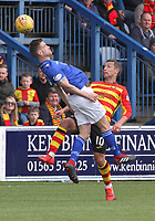 Kyle Jacobs gets the better of Scott McDonald in the air in the SPFL Ladbrokes Championship football match between Queen of the South and Partick Thistle at Palmerston Park, Dumfries on  4.5.19.