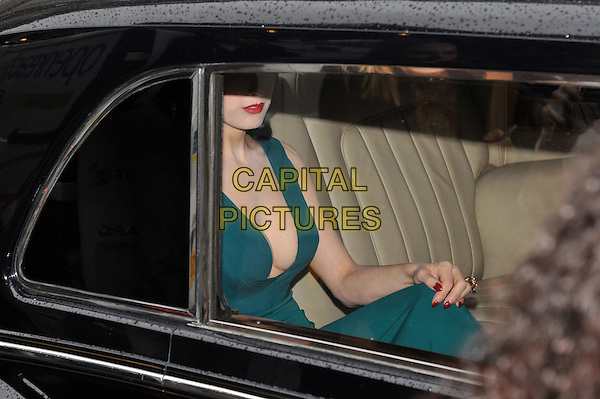 Dita Von Teese .Dita Von Teese, the burlesque superstar, appeared at Liberty London to launch her debut fragrance, named after herself, London, England..May 1st, 2012.perfume half length dress low cut neckline cleavage red lipstick teal blue green car sitting.CAP/BF.©Bob Fidgeon/Capital Pictures.