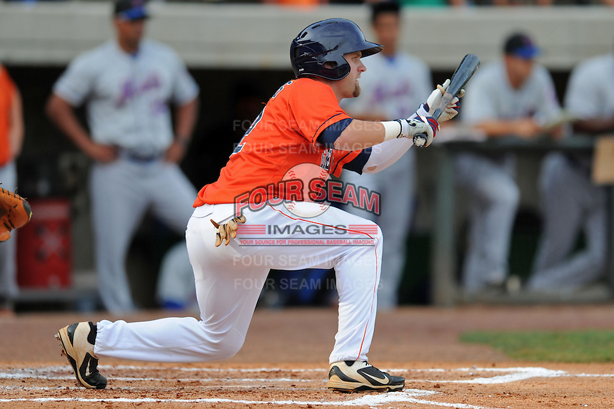 Greenville Astros center fielder Tanner Mathis #12 squares to bunt during a game against the Kingsport Mets at Pioneer Park on August 4, 2013 in Greenville, Tennessee. The Astros won the game 17-1. (Tony Farlow/Four Seam Images)