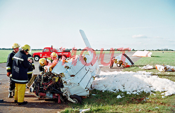 Firefighters attending a crashed light aircraft. They have covered the area in foam to stop the chance of the aircraft catching fire. This image may only be used to portray the subject in a positive manner..©shoutpictures.com..john@shoutpictures.com