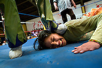 17 year old wrestler Marina de La Paz (fighting name), Marina Kaly Yujra (real name) has her head stamped on by Picudo during a fight at the Multifuncional building in El Alto. Marina is a Cholita, a wrestler of native Aymara descent. When Cholitas fight they wear traditional costume.