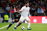 Spain's Isco Alarcon (r) and Argentina's Fabricio Bustos during international friendly match. March 27,2018. *** Local Caption *** © pixathlon<br /> Contact: +49-40-22 63 02 60 , info@pixathlon.de