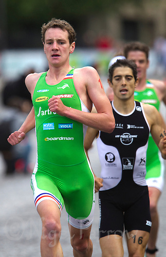 09 JUL 2011 - PARIS, FRA - Alistair Brownlee (EC Sartrouville) leads Joao Silva (Les Sables Vendee Tri) and his brother Jonathan Brownlee (also EC Sartrouville) during the men's French Grand Prix series race (PHOTO (C) NIGEL FARROW)