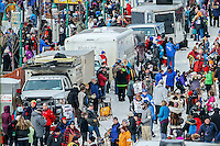 Dog teams stage in a line up down 4th avenue as they get ready to leave the start line during the Ceremonial Start of the 2016 Iditarod in Anchorage, Alaska.  March 05, 2016