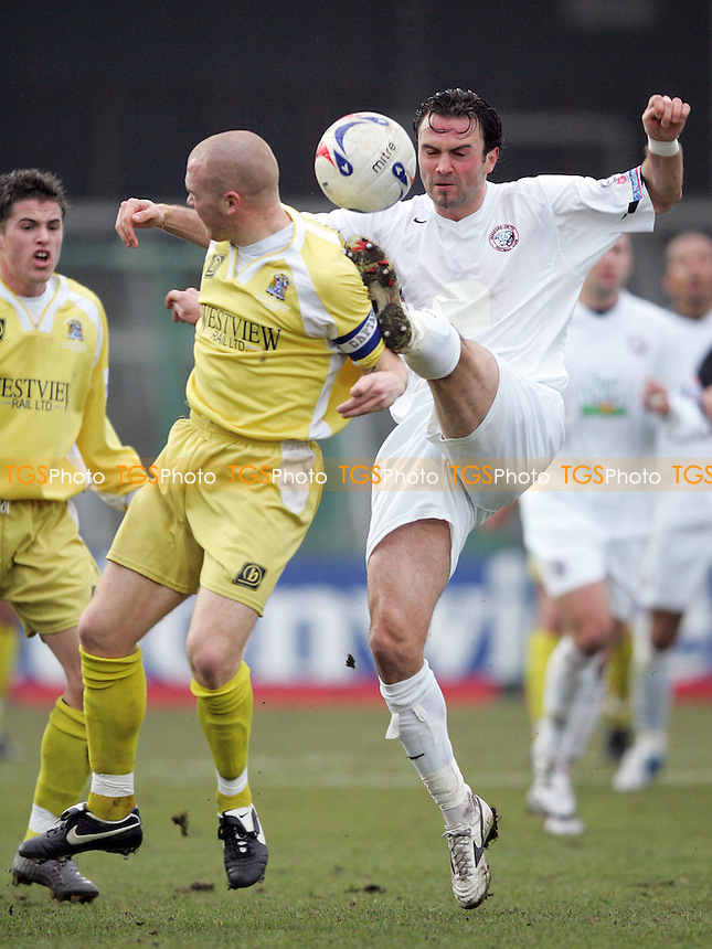 Hereford United vs Grays Athletic - FA Challenge Trophy 3rd Round - Grays skipper Stuart Thurgood takes evasive action as Hereford's Alex Jeannin swings a high boot - 04/02/06 - Mandatory credit: Gavin Ellis - (If used, will be invoiced at standard NUJ stock rates)