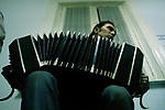 Flavio Regiani, 26, plays the bandoneon (a small accordion, a  German bellows instruments that produce the quintessential sound of the tango) during a music class in which students were asked to put a new music to and old tango song, at the National Academy of Tango in Buenos Aires, May 16, 2003.. Photo by Quique Kierszenbaum