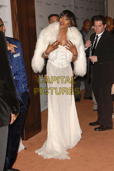 NAOMI CAMPBELL .attends The Clive Davis Pre-Grammy Party .held at The Beverly Hilton Hotel in Beverly Hills, California, USA,  February 10 2007..full length white dress fluffy fur wrap jacket shawl beaded back behind funny hands over cleavage breasts.CAP/DVS.©Debbie VanStory/Capital Pictures