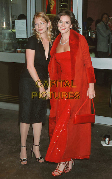 "MICHELLE WILLIAMS & ANNA FRIEL..""Me Without You"" Film Premiere...Ref: 11250..full length, full-length, black dres, plunging neckline, long red dress, red coat, red purse, red bag..www.capitalpictures.com..sales@capitalpictures.com..©Capital Pictures.."
