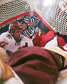 A pair of officials get involved after Tim Kunes (BC 6) and Matt McCollem (Harvard 23) join John Muse (BC 1) in the net. The Boston College Eagles defeated the Harvard University Crimson 6-5 in overtime on Monday, February 11, 2008, to win the 2008 Beanpot at the TD Banknorth Garden in Boston, Massachusetts.