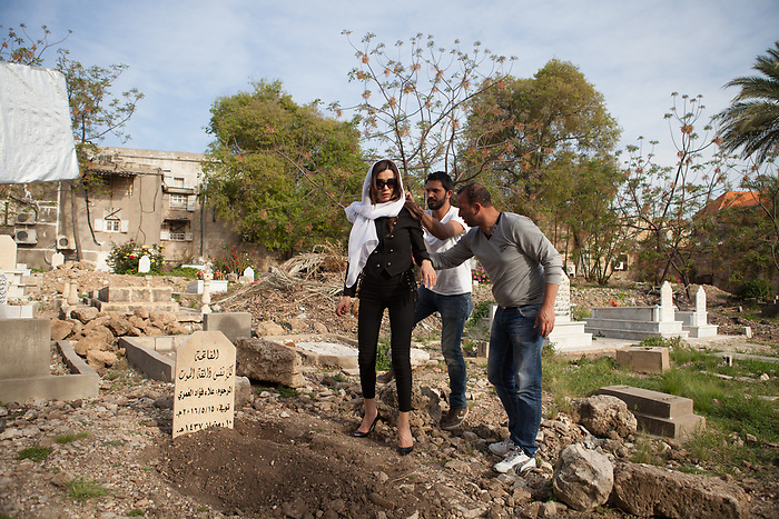 Shooting of the series &ldquo;Jareemat Shaghaf&rdquo; (&ldquo;Passionate Crime&rdquo;), Lebanon mars 2016 (Media 7 revolution). The actress Nadine El Rasi in preparing for a prayer scene at the cemetery. The plate has been inscribed for the scene, but the shooting is in a real cemetery.<br /> <br /> Tournage de la s&eacute;rie la s&eacute;rie &quot;Jareemat Shaghaf&quot; (&quot;Crime Passionnel&quot;) Liban, Mars 2016 (Media revolution 7). L'actrice Nadine El Rasi est pr&eacute;par&eacute;e pour une sc&egrave;ne de pri&egrave;re au cimeti&egrave;re. La plaque de la tombe a &eacute;t&eacute; grav&eacute;e pour la sc&egrave;ne, tandis que le tournage se d&eacute;roule dans un vrai cimeti&egrave;re.