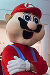Garden City, New York, USA. November 30, 2013. Super Mario, the Nintendo game character, is at the Winter holiday event Festival of Trees, held at Cradle of Aviation Museum during Thanksgiving weekend, with proceeds benefiting United Cerebral Palsy Association of Nassau County, Long Island.