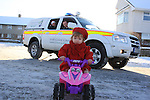 3 Year old Briena Collier showing off her new 4x4 electric quad bike that Santa delivered for getting around the snow covered streets in Drogheda, Shows it off to Members of Drogheda Unit of the Irish Cost Guard who were out helping out some of the senior citizens get to the Drogheda Senior Citizens christmas Dinner in Ballsgrove Drogheda..Picture Fran Caffrey/www.newsfile.ie.