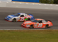 June 11, 2006; Long Pond, PA, USA; Nascar Nextel Cup driver Brian Vickers (25) races Tony Stewart (20) during the Pocono 500 at Pocono Raceway. Mandatory Credit: Mark J. Rebilas.