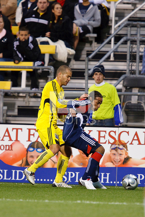 25 OCTOBER 2009:  Alejandro Moreno of the Columbus Crew (10) and Kevin Alston of the New England Revolution (30) during the New England Revolution at Columbus Crew MLS game in Columbus, Ohio on October 25, 2009.