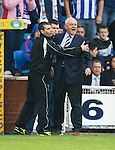 Walter Smith has a go at Connor Sammon and is restrained by the fourth official