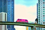 An elevated Metromover crosses over the Miami River in the Brickell neighborhood of downtown Miami, Florida.  The free mass transit automated people mover has been a catalyst for downtown development.