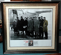 Pictured: The commemorative frame showing the players boarding the tragic Munich air disaster aeroplane, Kenny Moorgan shown far RIGHT. Monday 14 November 2011<br /> Re: 72 year old Kenny Morgans (correct) who signed for Manchester United on leaving school in the summer of 1955 <br /> He suffered minor injuries in the Munich air disaster, when still only 18 years old and was found unconscious amongst the debris by two journalists five hours after the official search was called off.<br /> He made a full recovery following the crash but never regained his form on the pitch and later played in the lower divisions for Swansea Town and Newport County before retiring from football in 1967.
