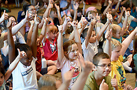 NWA Democrat-Gazette/DAVID GOTTSCHALK Children in the audience interact Wednesday, July 3, 2019, with Jeff Koziatek during the Juggling Jeff Comedy Show at the Fayetteville Public Library. Juggling Jeff performed two shows that featured comedy, audience interaction and juggling a variety of items that included diapers.