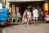 PHILIPPINES, Manila, Qulapo District, kids play in the street at the Quina Market