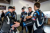 DAYTONA BEACH, FL - JAN 24: Drivers, L to R, Samui Kobayashi , of Japan, Renger van dr Zande, of the Netherlands, Scott Dixon, of New Zealand, and Ryan Briscoe, of Australia, talk with team manager Travis Hogue, 2nd from right,  before the Rolex 24 at Daytona at Daytona International Speedway, Daytona Beach, Florida,  January 24, 2020. (Photo by Brian Cleary/BCPix.com)