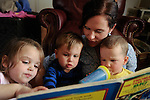 "Amanda Waterstrat reads a ""Thomas the Engine"" book with Allie Horn, 4, Noah Horn, 2, and her son Finley, 2, after they wake up from a midday nap. Amanda and Ford Waterstrat said they want to have more children, but need more space for the bigger family. They are currently building an addition to the house to make that happen."